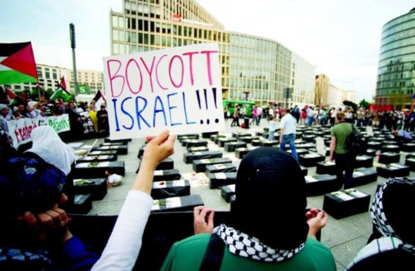 An anti-Israeli protest inspired by BDS (photo credit: REUTERS)
