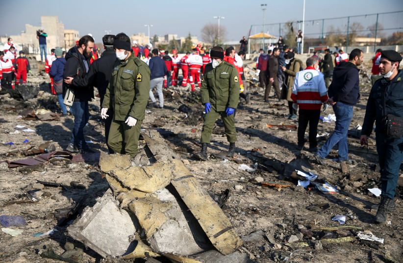 Security officers and Red Crescent workers are seen at the site where the Ukraine International Airlines plane crashed after take-off from Iran's Imam Khomeini airport, on the outskirts of Tehran, Iran January 8, 2020. (photo credit: NAZANIN TABATABAEE/WANA (WEST ASIA NEWS AGENCY) VIA REUTERS)