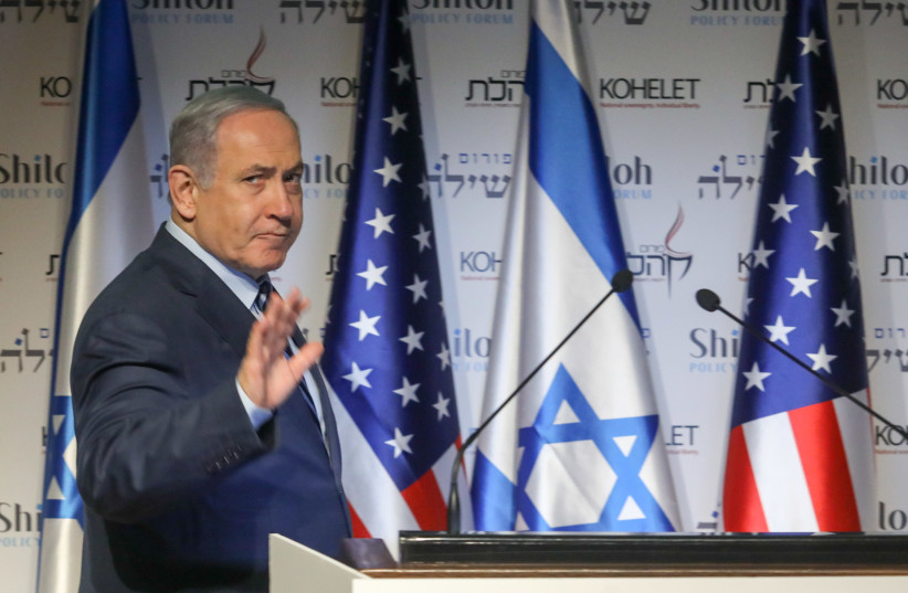 PRIME MINISTER Benjamin Netanyahu speaks during a conference in Jerusalem Wednesday. Will the US action in Iraq help his campaign? (photo credit: REUTERS/Ronen Zvulun)