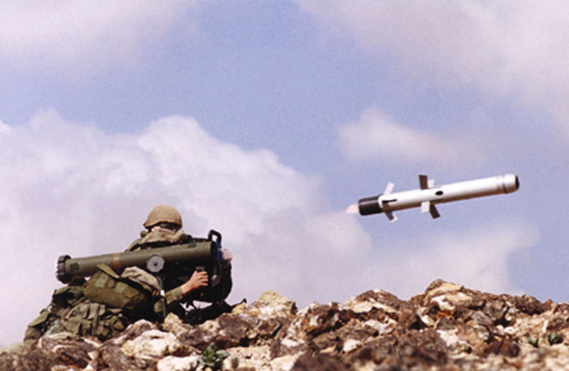 An undated file picture shows an Israeli soldier firing an anti-tank missile Spike-LR, manufactured by an Israeli Defense contractor. Israeli Defense Ministry said December 29, 2003, it signed a deal worth about $250 million to produce and supply anti-tank missiles to Poland. (photo credit: RAFAEL ADVANCED SYSTEMS)