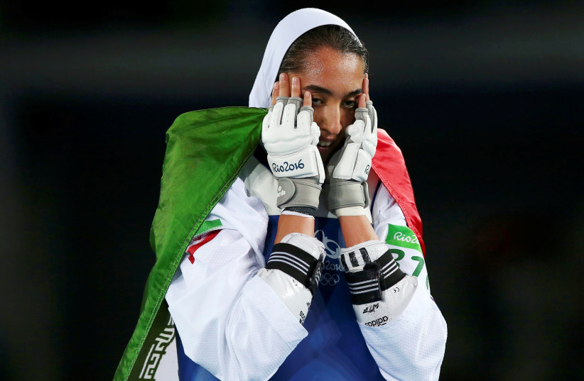 FILE PHOTO: 2016 Rio Olympics - Taekwondo - Women's -57kg Bronze Medal Finals - Carioca Arena 3 - Rio de Janeiro, Brazil - 18/08/2016. Kimia Alizadeh Zenoorin (IRI) of Iran celebrates (photo credit: REUTERS/PETER CZIBORRA)