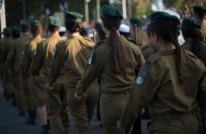 Female IDF intelligence officers march in a ceremony (photo credit: IDF SPOKESPERSON'S UNIT)