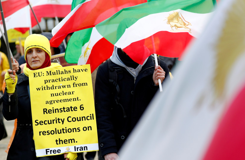 Supporters of the National Council of Resistance of Iran (NCRI) protest as European Union foreign ministers attend an emergency meeting in Brussels, Belgium, January 10, 2020. (photo credit: REUTERS/FRANCOIS LENOIR)