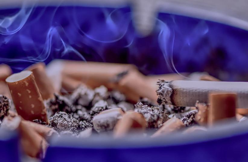 Cigarettes and ashtray, illustrative (photo credit: PXFUEL)
