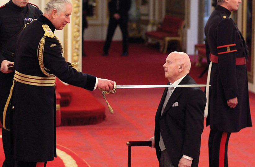 Ben Helfgott is knighted by Prince Charles at Buckingham Palace (photo credit: Courtesy)