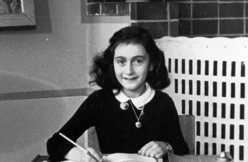 Anne Frank at her writing table in 1940; how many Anne Franks were lost in the Holocaust? (photo credit: Wikimedia Commons)