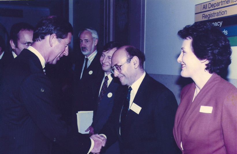 The writer, then a director of a UK cancer charity, meets its patron, Prince Charles, in 1994 (photo credit: Courtesy)