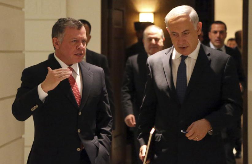 Jordan's King Abdullah (L) walks with Israel's Prime Minister Benjamin Netanyahu before their meeting at the Royal Palace in Amman January 16, 2014 (photo credit: REUTERS/JORDANIAN ROYAL PALACE/YOUSEF ALLAN/HANDOUT VIA REUTERS)