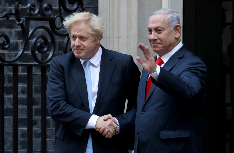 Britain's Prime Minister Boris Johnson welcomes Israel's Prime Minister Benjamin Netanyahu outside Downing Street in London, Britain September 5, 2019. (photo credit: SIMON DAWSON/ REUTERS)