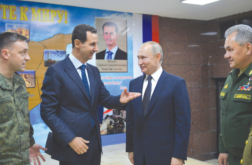 RUSSIAN PRESIDENT Vladimir Putin meets with his Syrian counterpart, Bashar Assad, in Damascus last week. (photo credit: SPUTNIK/ALEXEI DRUZHININ/KREMLIN VIA REUTERS)