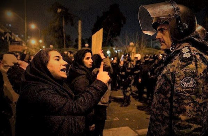 Women facing down soldiers in Tehran at a protest following the downing of a Ukrainian airliner (photo credit: IRAN LIBERATION CONGRESS)