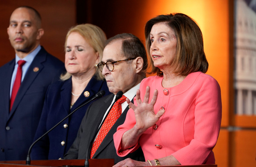 U.S. house Speaker Nancy Pelosi (D-CA) announces the House of Representatives managers, including Reps'. Hakeem Jeffries (D-NY), Slyvia Garcia (D-TX) and Jerrold Nadler (D-NY) for the Senate impeachment trial of U.S. President Donald Trump during a news conference at the U.S. Capitol in Washington,  (photo credit: JOSHUA ROBERTS / REUTERS)