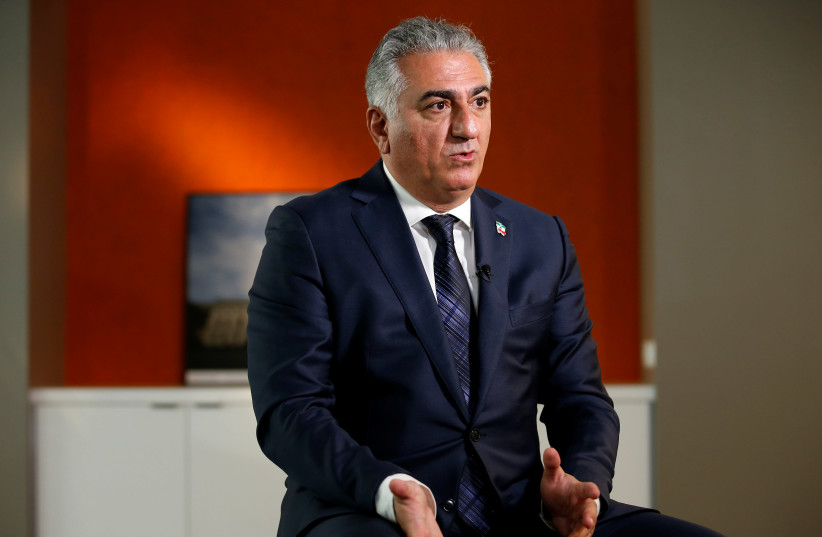 Reza Pahlavi, the last heir apparent to the defunct throne of the Imperial State of Iran and the current head of the exiled House of Pahlavi speaks during an interview with Reuters in Washington, U.S., January 3, 2018. (photo credit: REUTERS/JOSHUA ROBERTS)
