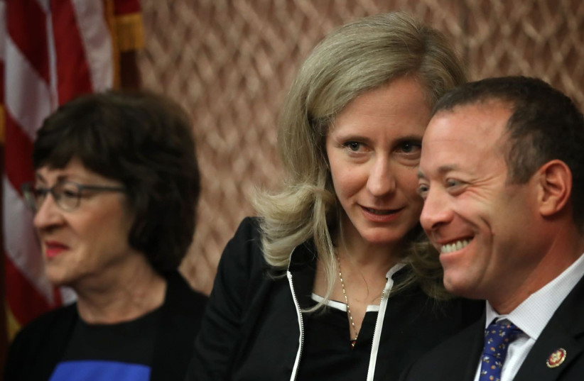 Rep. Abigail Spanberger (C) (D-VA) confers with Rep. Josh Gottheimer (R) (D-NJ) during a press conference held by the bipartisan and bicameral Problems Solvers Caucus at the U.S. Capitol in Washington, DC on June 27, 2019 (photo credit: WIN MCNAMEE/GETTY IMAGES/JTA)