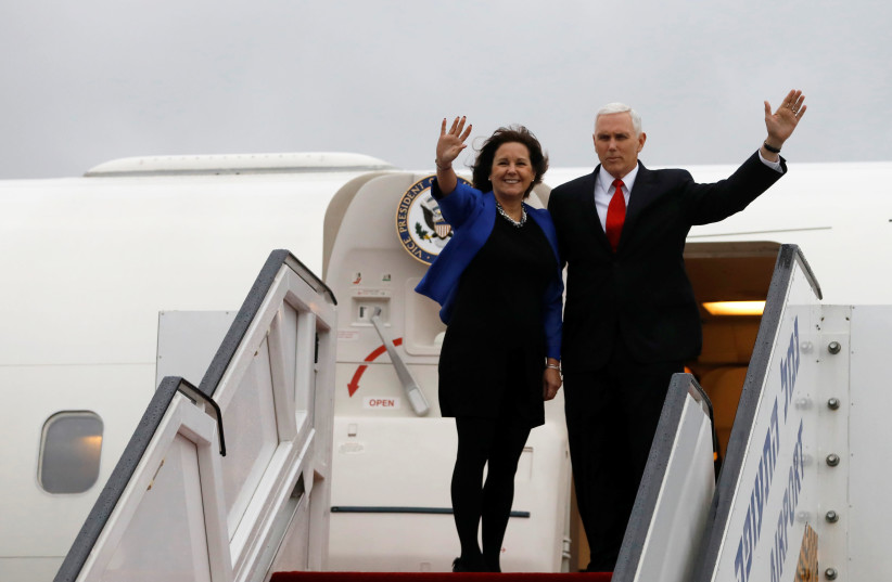 U.S. Vice President Mike Pence and his wife Karen wave as they board an airplane ahead of their departure from Ben Gurion International airport in Lod, near Tel Aviv (photo credit: REUTERS/Ronen Zvulun)