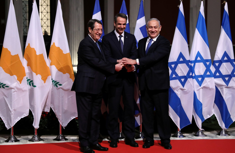 Cypriot President Nicos Anastasiades, Greek Prime Minister Kyriakos Mitsotakis and Israeli Prime Minister Benjamin Netanyahu pose for a photo before signing a deal to build the EastMed subsea pipeline to carry natural gas from the eastern Mediterranean to Europe, at the Zappeion Hall in Athens, Gree (photo credit: REUTERS/ALKIS KONSTANTINIDIS)