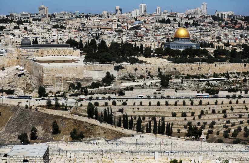 A general view of Jerusalem as seen from the Mount of Olives shows the Dome of the Rock, located in Jerusalem's Old City on the compound known to Muslims as Noble Sanctuary and to Jews as Temple Mount, June 21, 2018 (photo credit: REUTERS/AMMAR AWAD)