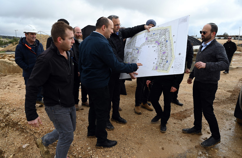 Then Minister of Defense Naftali Bennett visits new housing projects in Judea and Samaria (photo credit: ARIEL HERMONI/DEFENSE MINISTRY)