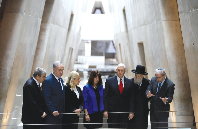 US Vice President Mike Pence and his wife, Karen (center), stand alongside Prime Minister Benjamin Netanyahu and his wife, Sara, at the Yad Vashem Holocaust History Museum in Jerusalem in 2018. (photo credit: RONEN ZVULUN/REUTERS)