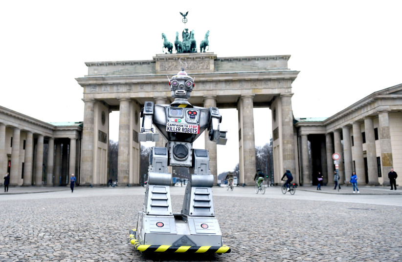 A ROBOT is pictured as activists from the Campaign to Stop Killer Robots stage a protest at Brandenburg Gate in Berlin last year. (photo credit: REUTERS)
