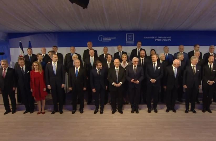 President Reuven Rivlin [C] and world leaders in a group photo taken in Jerusalem January 22 2020  (photo credit: screenshot)