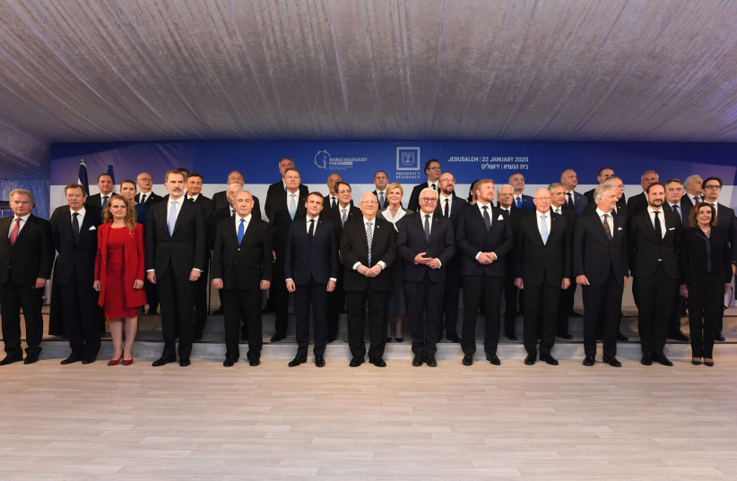 President Reuven Rivlin [C] and world leaders in a group photo taken in Jerusalem January 22 2020 (photo credit: KOBI GIDEON/GPO)