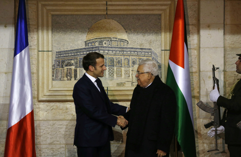 Palestinian President Mahmoud welcomes French President Emmanuel Macron at his headquarters in Ramallah in the West Bank, January 22, 2020 (photo credit: ABBAS MOMANI/POOL VIA REUTERS)
