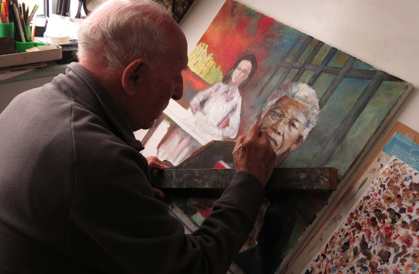 Michael Italiaander paints Anne Frank's influence on Nelson Mandela. (photo credit: MICHAEL ITALIAANDER)