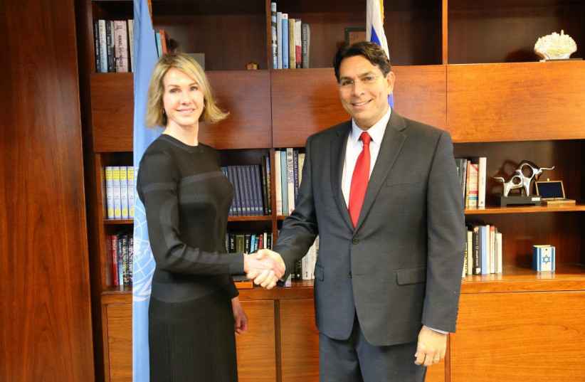 Danny Danon and Kelly Craft shaking hands (photo credit: ISRAELI DELEGATION TO THE UN)