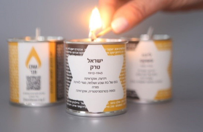 Lighting a candle in the memory of those who've perished in the Holocaust (photo credit: MARK NAYMAN)