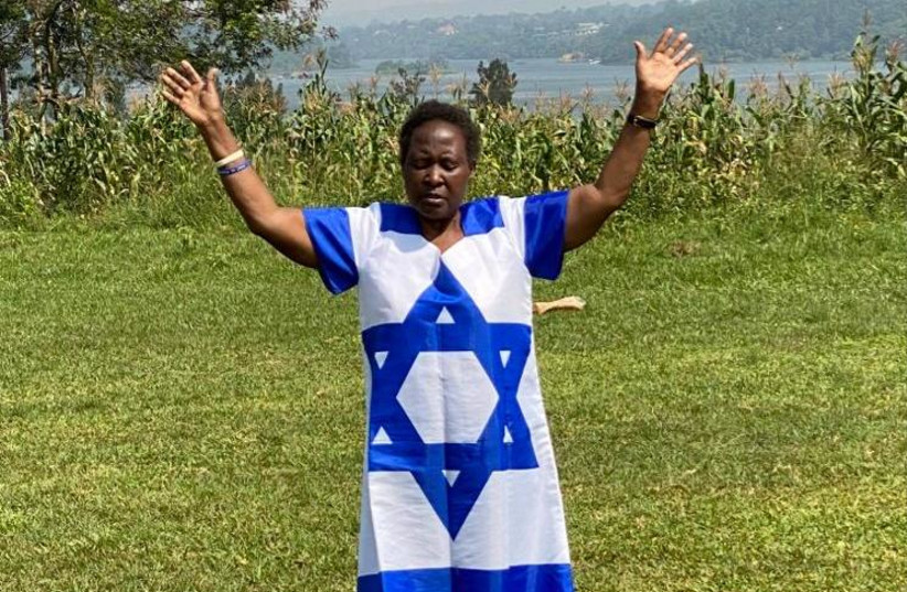 African woman prays for Israel (photo credit: Courtesy)