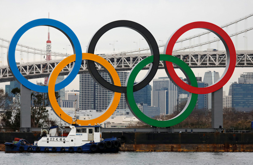 Giant Olympic Rings are installed at the waterfront area at Odaiba Marine Park in Tokyo, Japan, ahead of an official inauguration ceremony, six months before the opening of the Tokyo 2020 Summer Olympic Games, January 17, 2020 (photo credit: REUTERS/ISSEI KATO)