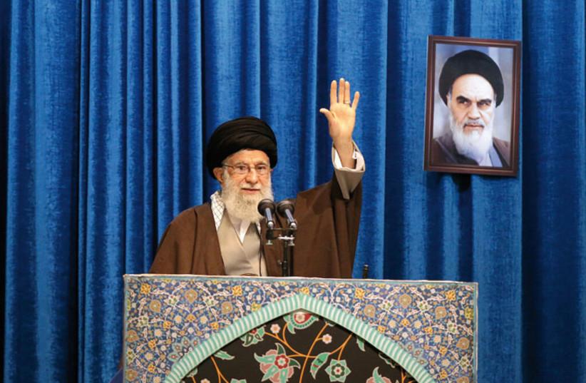 Iran's Supreme Leader Ayatollah Ali Khamenei gestures as he delivers a Friday prayer sermon in Tehran on January 17 (photo credit: REUTERS)