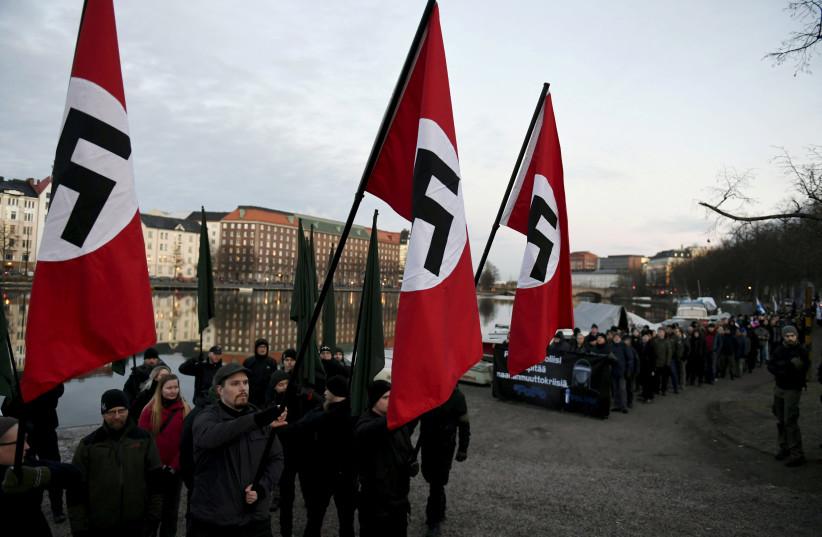 Neo-Nazis deny Holocaust, burn Israeli flag in Finland - The Jerusalem Post