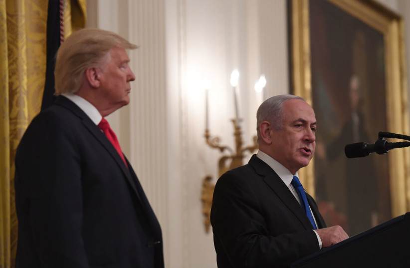 "U.S. President Trump and Israel's Prime Minister Netanyahu at the unveiling of Trump's ""Deal of the Century,"" January 28, 2020 (photo credit: KOBI GIDEON/GPO)"