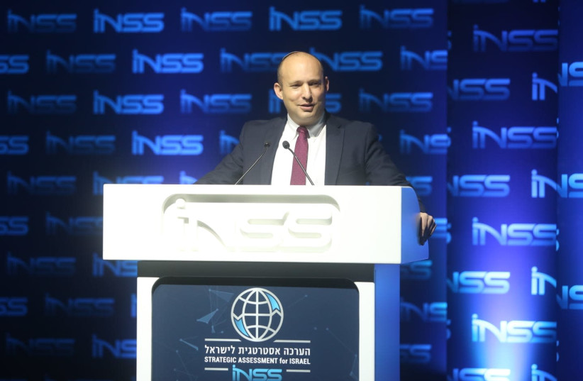 Defense Minister Naftali Bennett speaks at the INSS conference. (photo credit: CHEN GALILI)