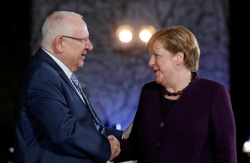 German Chancellor Angela Merkel receives Israeli President Reuven Rivlin at the Chancellery in Berlin, Germany, January 28, 2020 (photo credit: REUTERS/AXEL SCHMIDT)