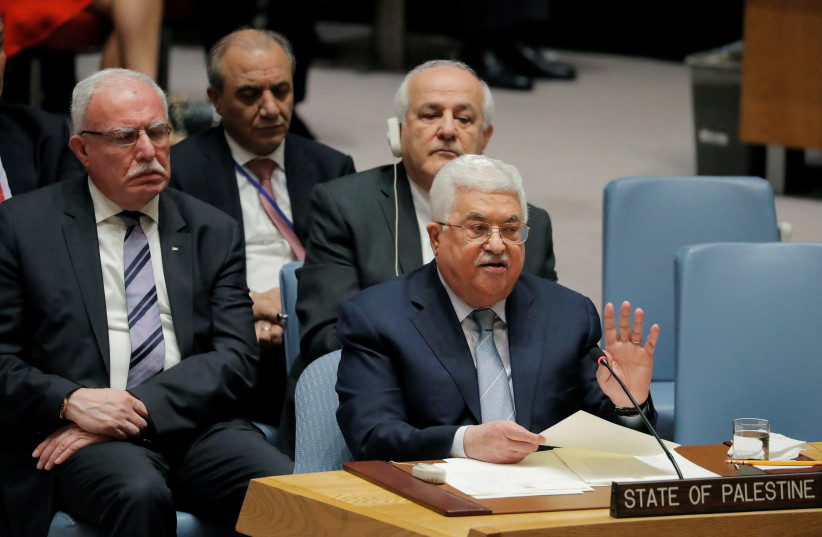 Palestinian President Mahmoud Abbas speaks during a meeting of the United Nations (UN) Security Council at UN headquarters in New York, U.S., February 20, 2018 (photo credit: REUTERS/LUCAS JACKSON)