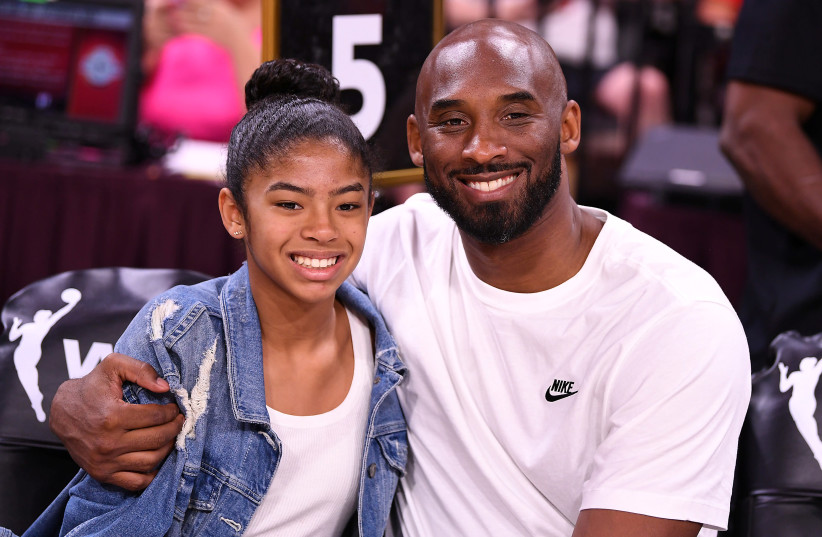FILE PHOTO: Jul 27, 2019; Las Vegas, NV, USA; Kobe Bryant is pictured with his daughter Gianna at the WNBA All Star Game at Mandalay Bay Events Center (photo credit: STEPHEN R. SYLVANIE-USA TODAY SPORTS/FILE PHOTO VIA REUTERS)