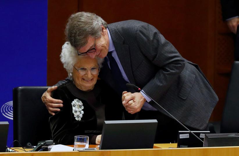 European Parliament President David Sassoli embraces Holocaust survivor Liliana Segre during the plenary session in memory of the victims of the Holocaust at the EU Parliament in Brussels, Belgium January 29, 2020 (photo credit: REUTERS/FRANCOIS LENOIR)