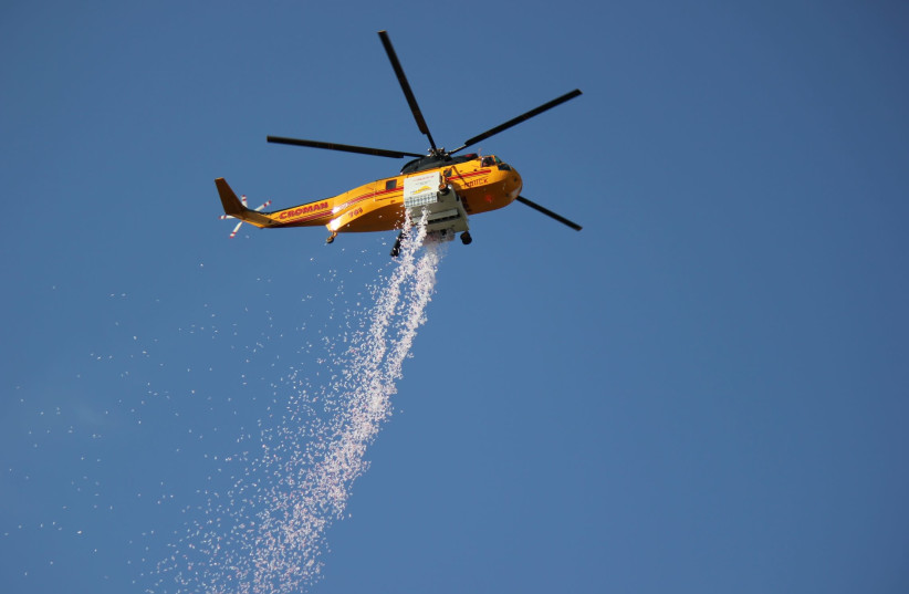 The Hydrop solution being dropped from on board a Croman aerial fire suppression helicopter. (photo credit: ELBIT SYSTEMS)