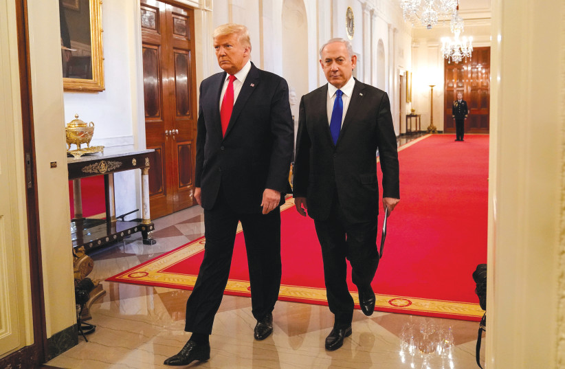 US PRESIDENT Donald Trump and Prime Minister Benjamin Netanyahu arrive to deliver joint remarks on a Middle East peace plan proposal at the White House Wednesday.  (photo credit: JOSHUA ROBERTS / REUTERS)