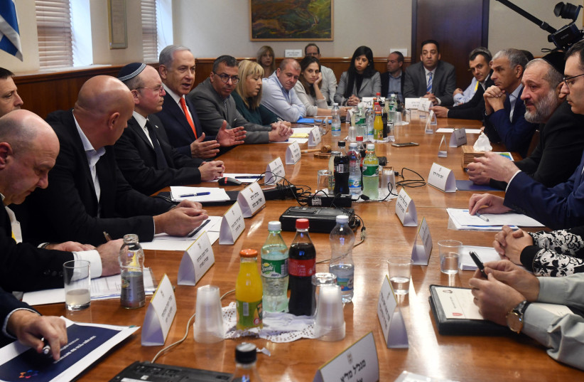 Prime Minister Benjamin Netanyahu holds an emergency meeting on the coronavirus epidemic. (photo credit: CHAIM TZACH/GPO)