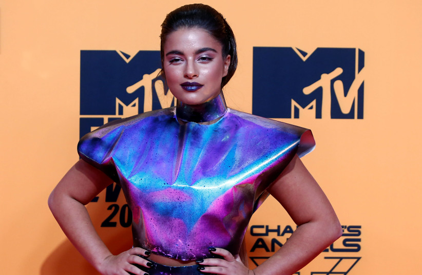Noa Kirel poses on a red carpet as she arrives at the 2019 MTV Europe Music Awards at the FIBES Conference and Exhibition Centre in Seville, Spain, November 3, 2019 (photo credit: JON NAZCA/ REUTERS)