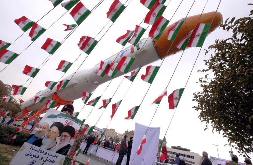 A model of Simorgh satellite-carrier rocket during a ceremony marking the 37th anniversary of the Islamic Revolution, in Tehran, Iran, February 11, 2016 (photo credit: RAHEB HOMAVANDI/REUTERS)