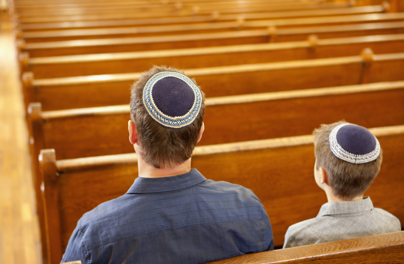 Father and son in a synagogue (photo credit: GABE FRIEDMAN (JTA))