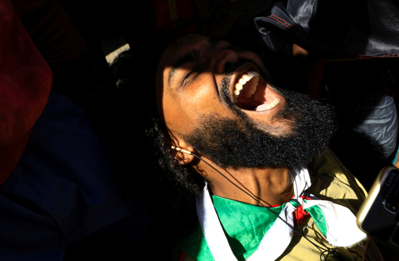 A Sudanese man reacts as he celebrates outside the court in Omdurman (photo credit: REUTERS)