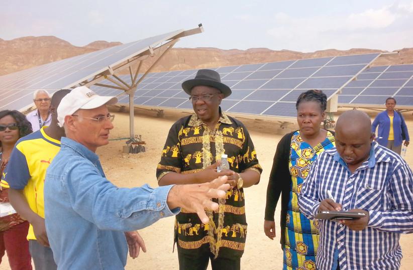 KIBBUTZ KETURA member Seth Kessler gives a tour to a Kenyan delegation. Six hundred million Africans do not have access to energy today. (photo credit: YOSEF ABRAMOWITZ)