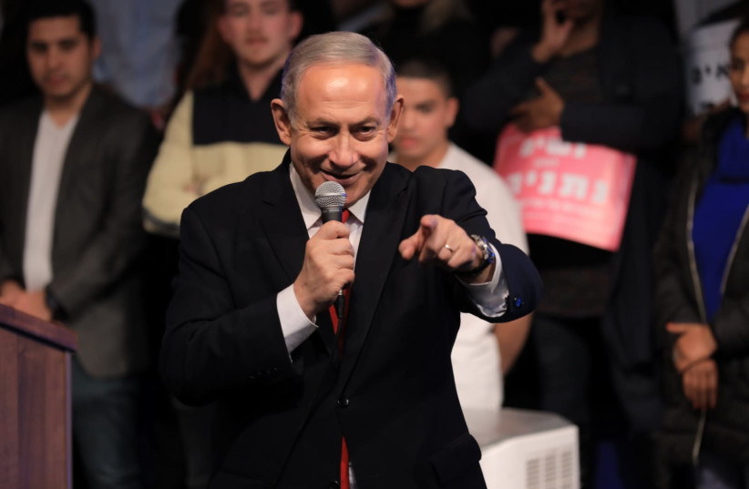 Prime Minister Benjamin Netanyahu addresses supporters at a Likud Party event, February 5, 2020 (photo credit: SHARON REVIVO)