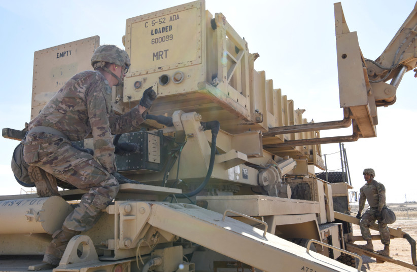 Specialist Tevin Howe and Specialist Eduardo Martinez take part in training on a U.S. Army Patriot surface-to-air missile launcher at Al Dhafra Air Base, United Arab Emirates, January 12, 2019. Picture taken January 12, 2019. U.S. Air Force/Tech (photo credit: SGT. DARNELL T. CANNADY/HANDOUT VIA REUTERS)